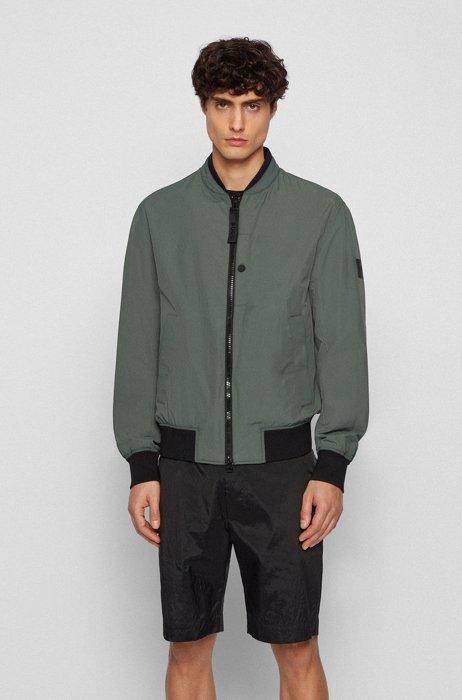 Water-repellent jacket with logo statements, Dark Green
