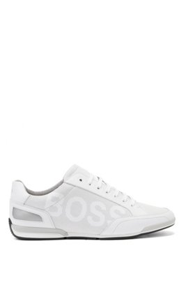 Low-profile leather trainers with perforated detailing, White