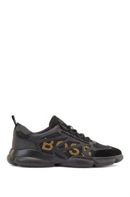 Lage sneakers met honingraatmesh en logodetails, Zwart