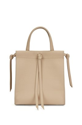 Grained-leather tote bag with knotted tassel trims, Beige