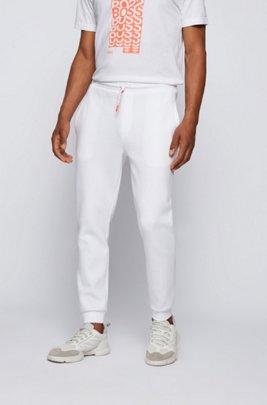 Jogginghose mit Beinbündchen und gestreifter Kordel, Weiß
