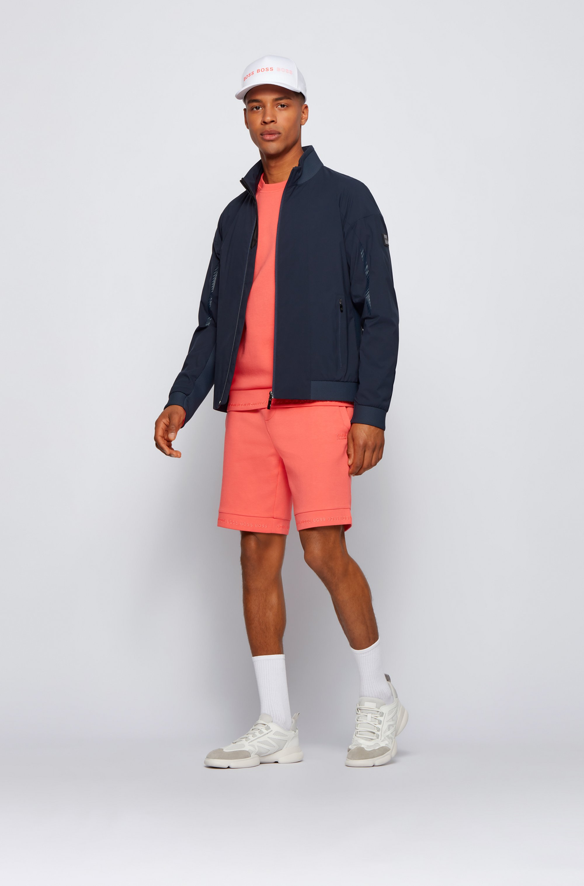 Regular-fit shorts in stretch jersey with logo hems