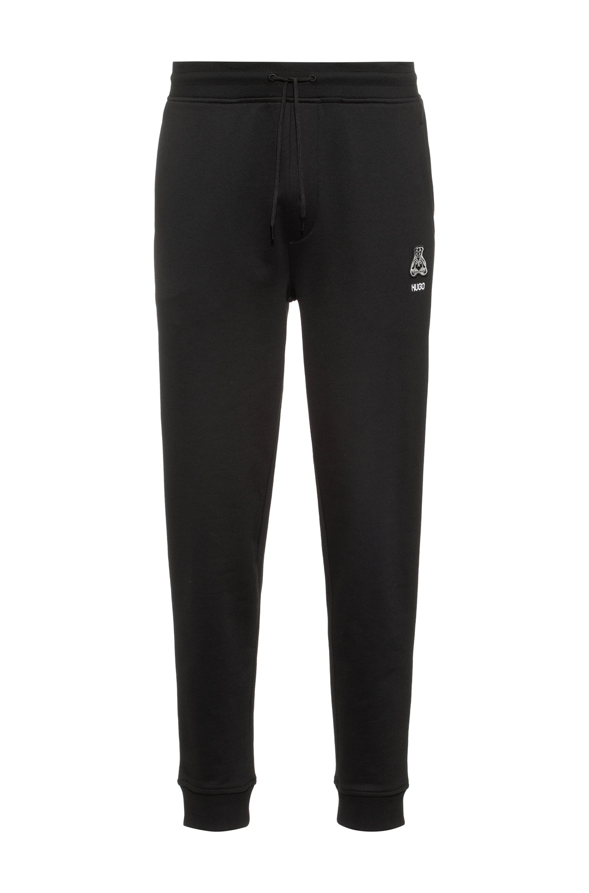 Regular-fit tracksuit bottoms in cotton with bear motif, Black