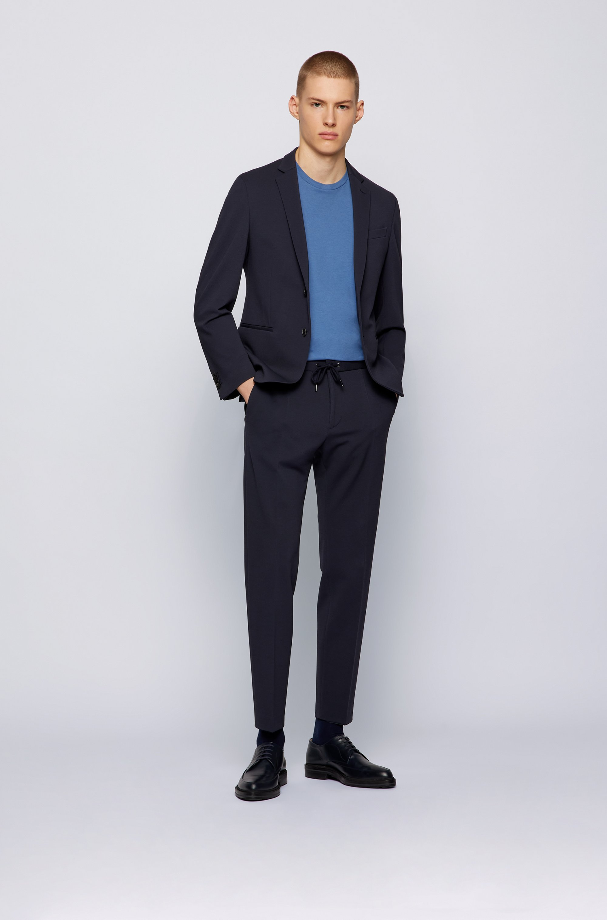 Slim-fit trousers in micro-patterned stretch fabric