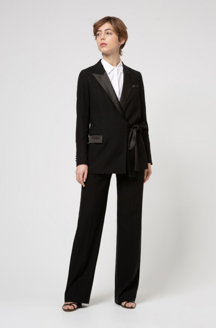 Relaxed-fit trousers in crepe fabric with lustrous piping