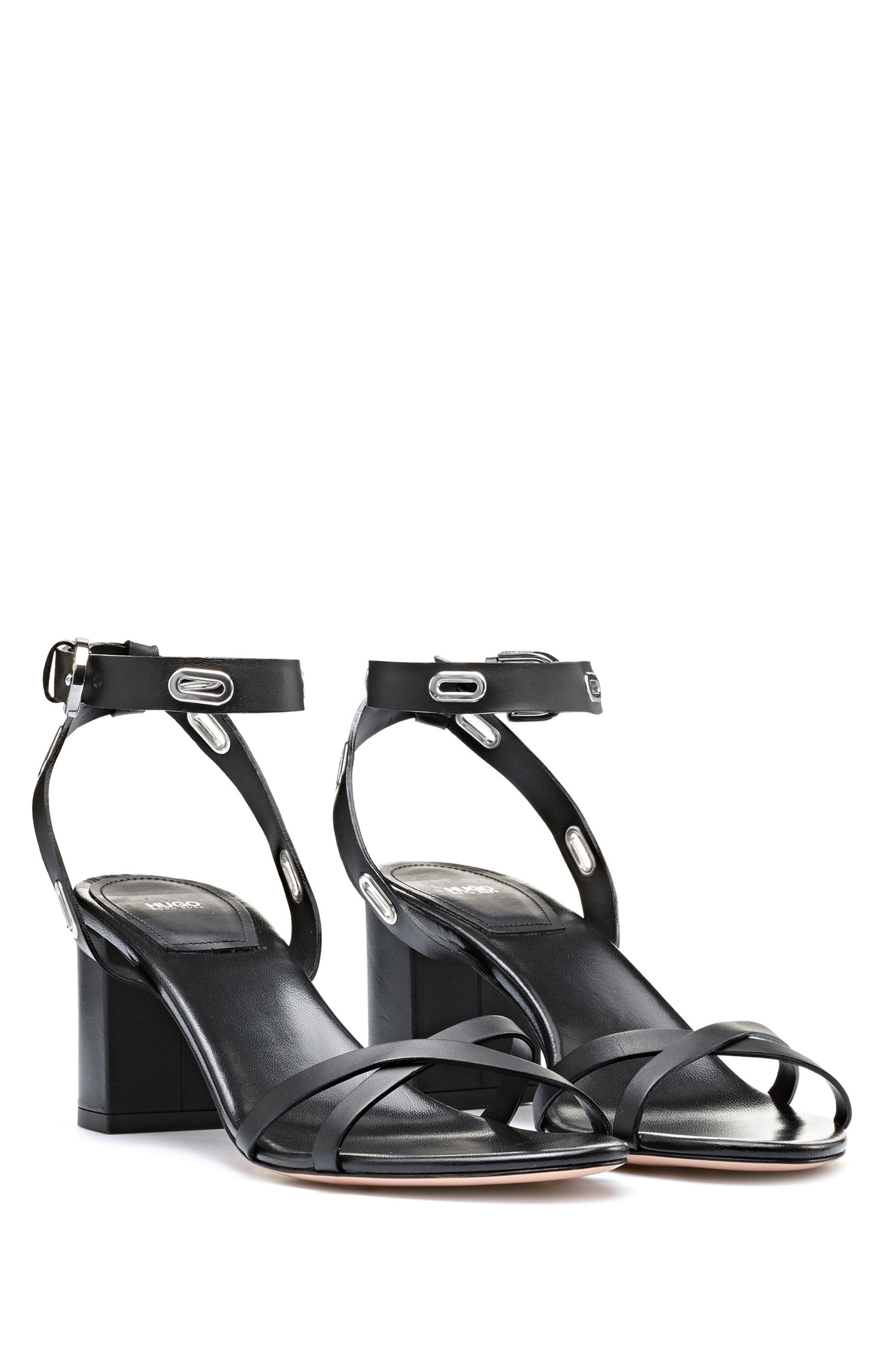 Heeled sandals in Italian leather trimmed with oval hardware