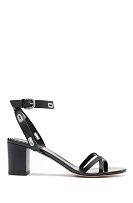 Heeled sandals in Italian leather trimmed with oval hardware, Black