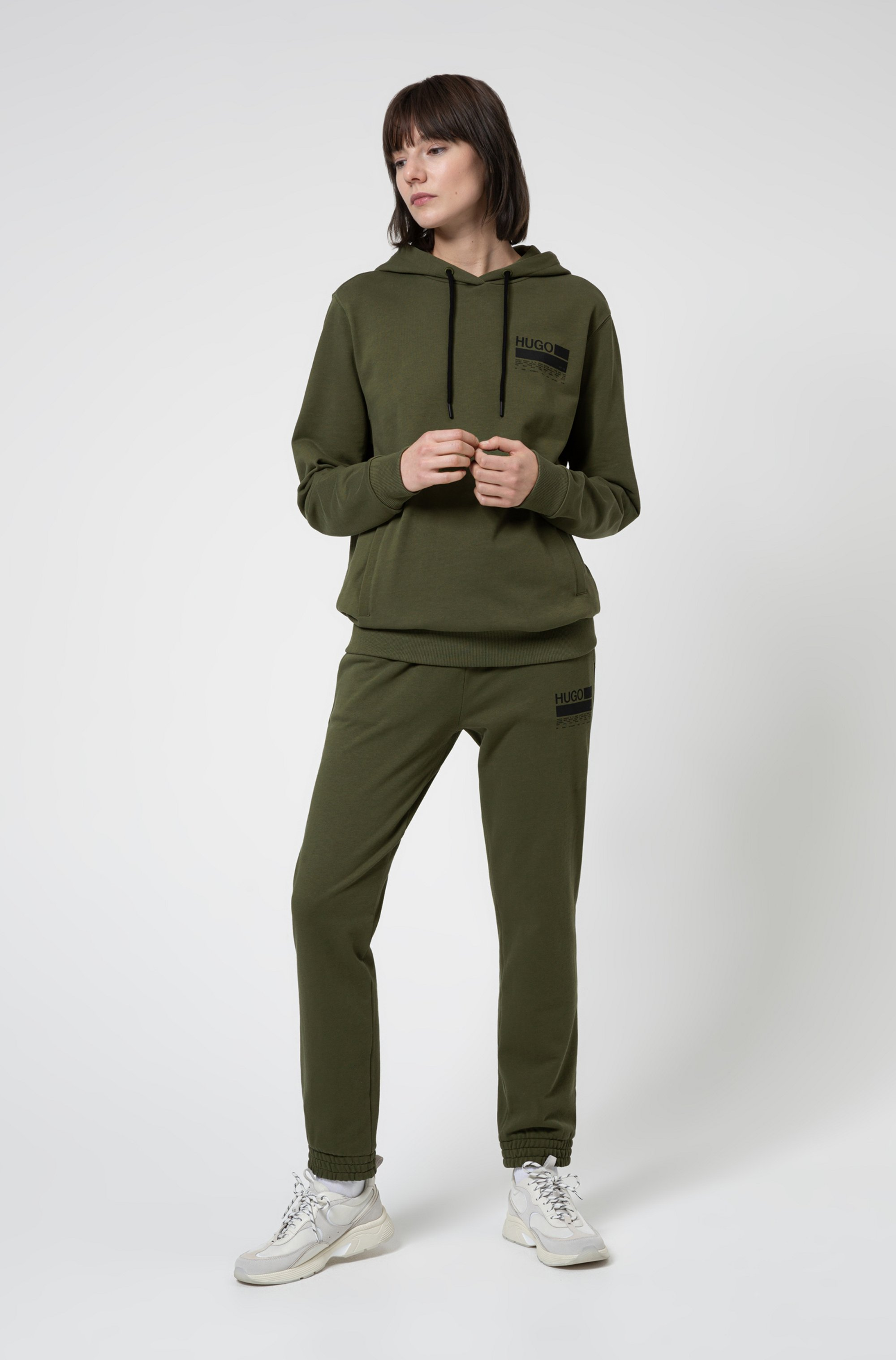 Relaxed-fit tracksuit bottoms with brand-manifesto logo