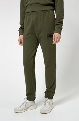 Relaxed-fit tracksuit bottoms with brand-manifesto logo, Khaki