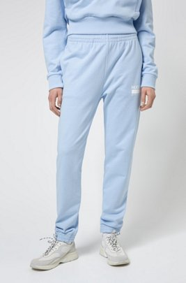 Relaxed-fit tracksuit bottoms with brand-manifesto logo, Light Blue