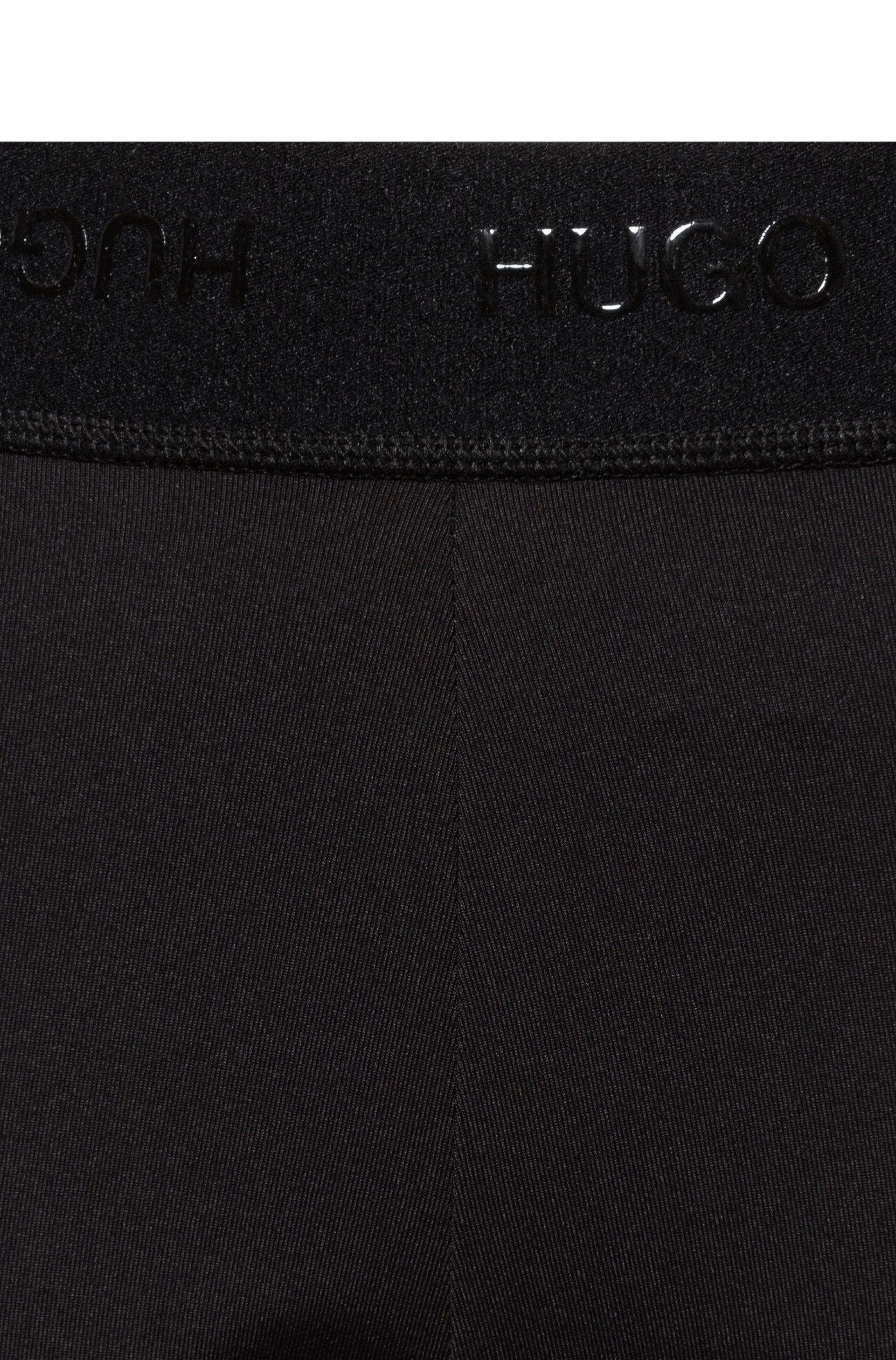 Skinny-fit leggings with hand-written logo print
