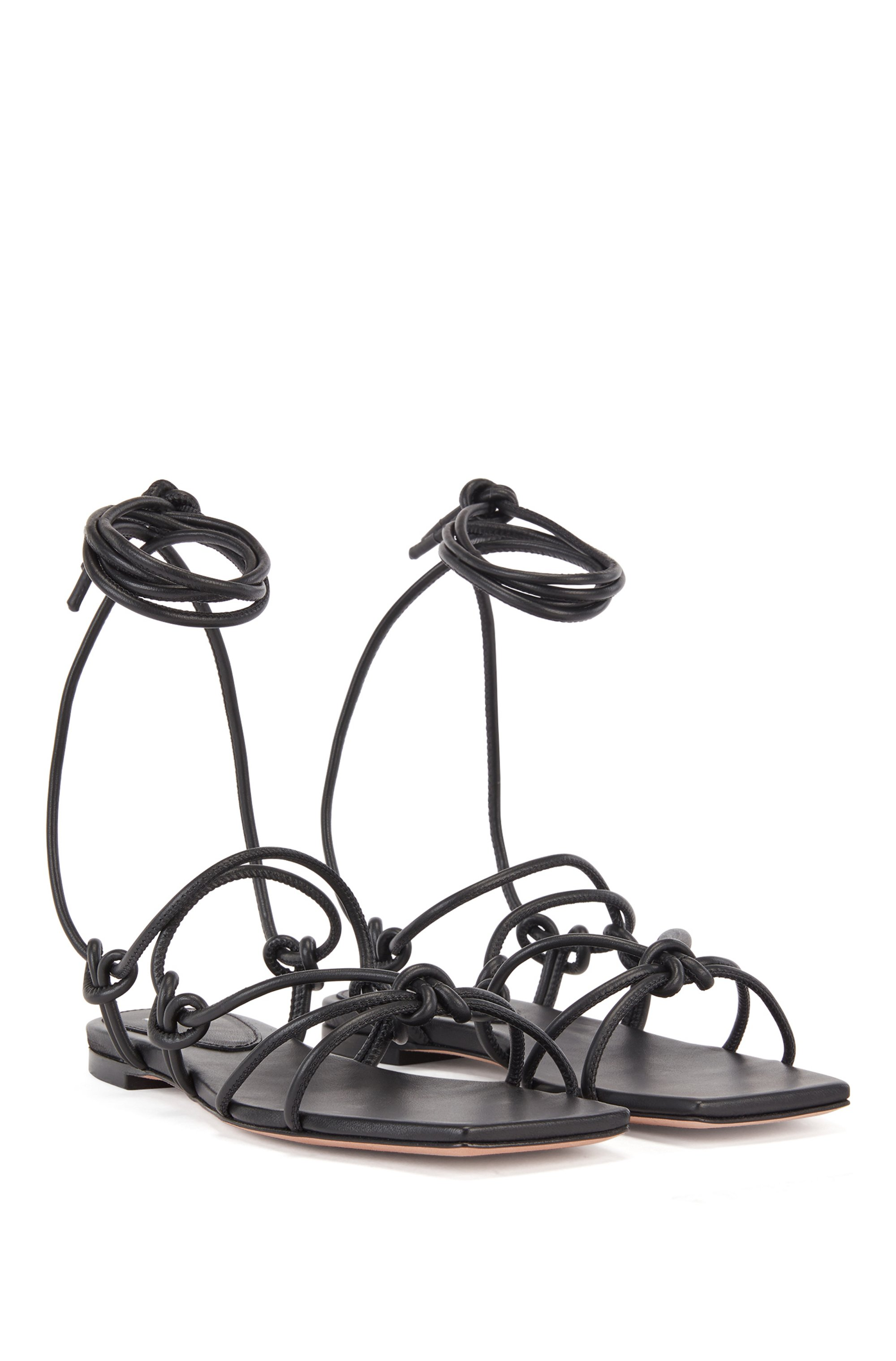 Flat sandals in nappa leather with tie-up straps