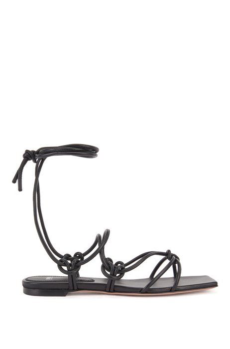 Sandalias planas en piel de napa con tiras anudadas, Negro