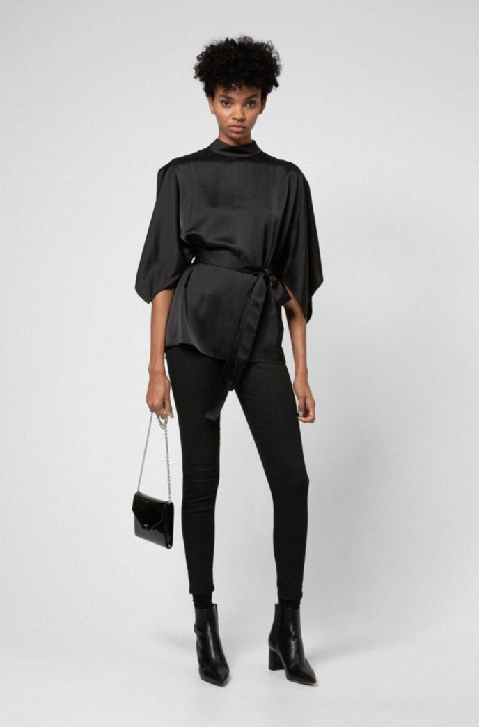 Belted top with kimono-style sleeves and stand collar