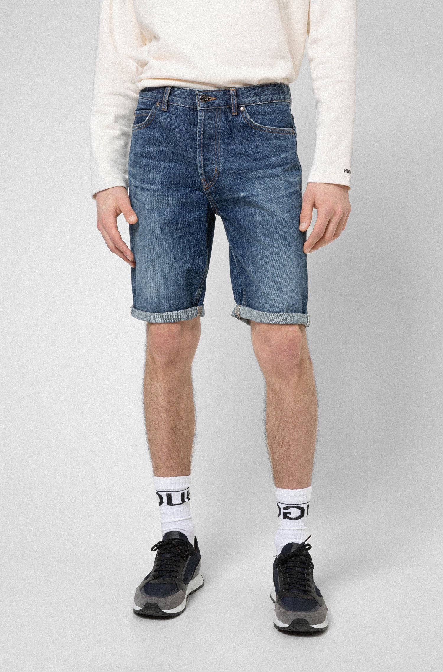 Blue tapered-fit denim shorts with manifesto logo patch, Blue