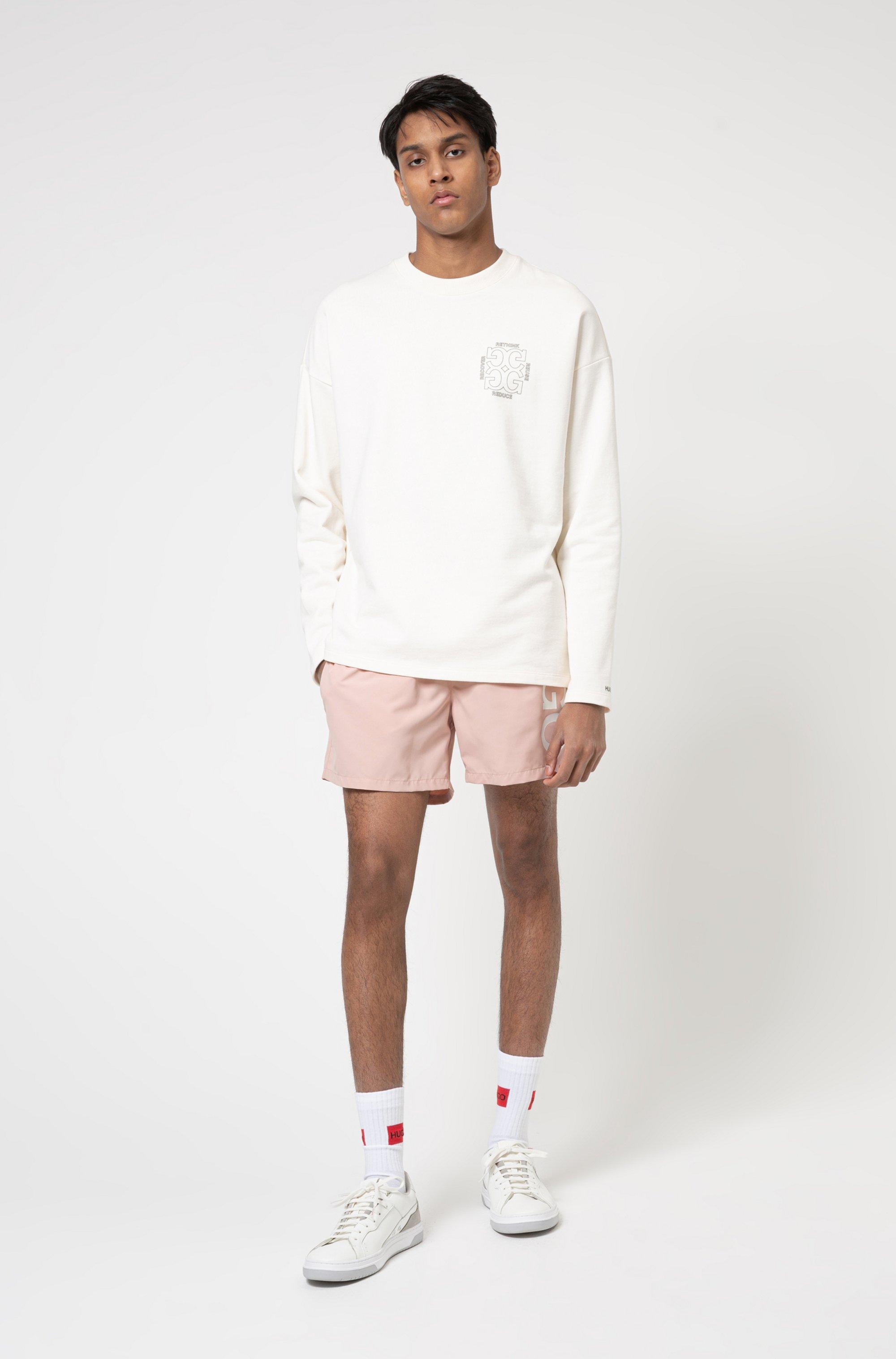 Regular-fit sweatshirt in Recot²® cotton with rear artwork