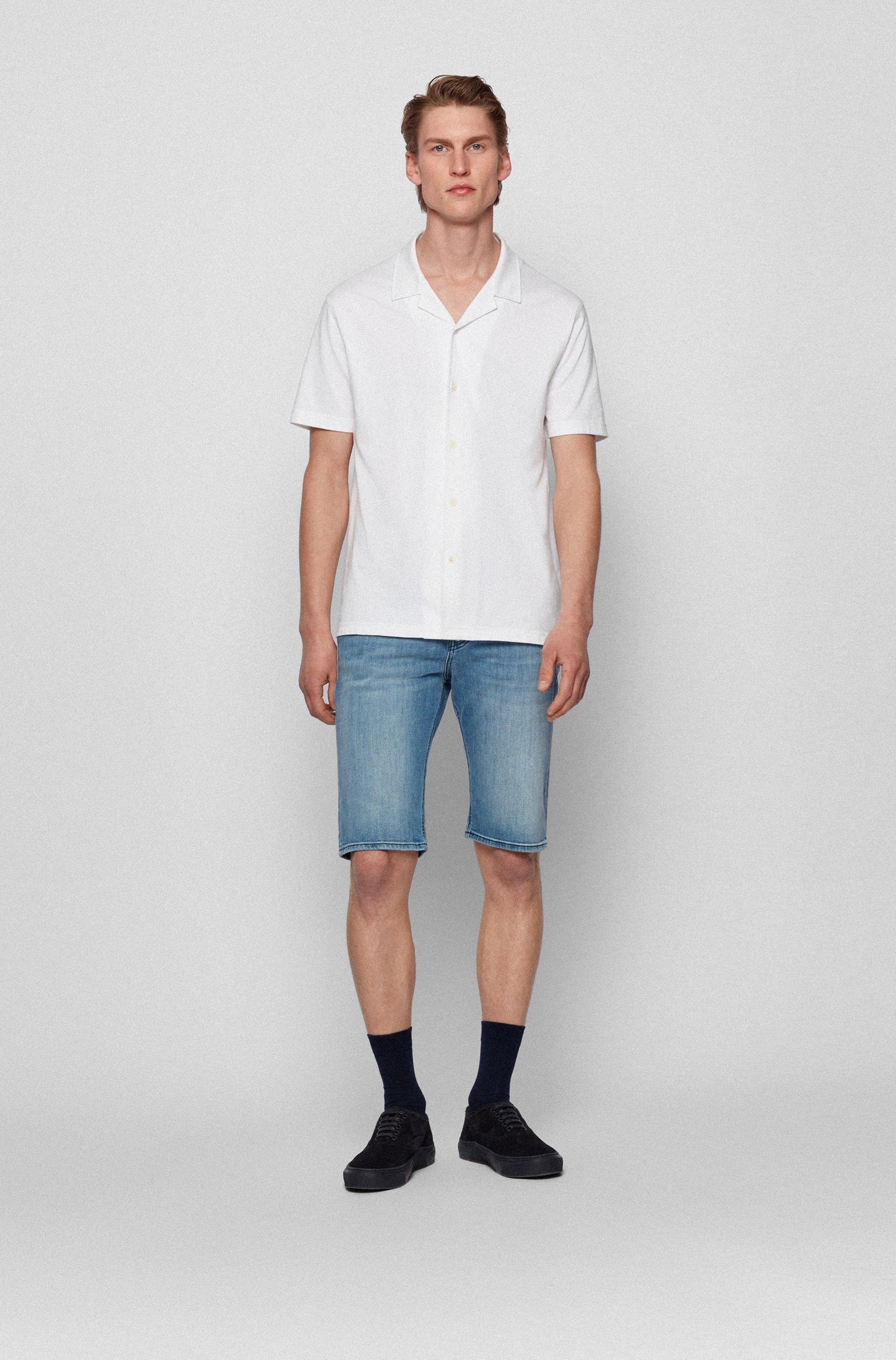 Tapered-fit shorts in bleached-blue super-stretch denim