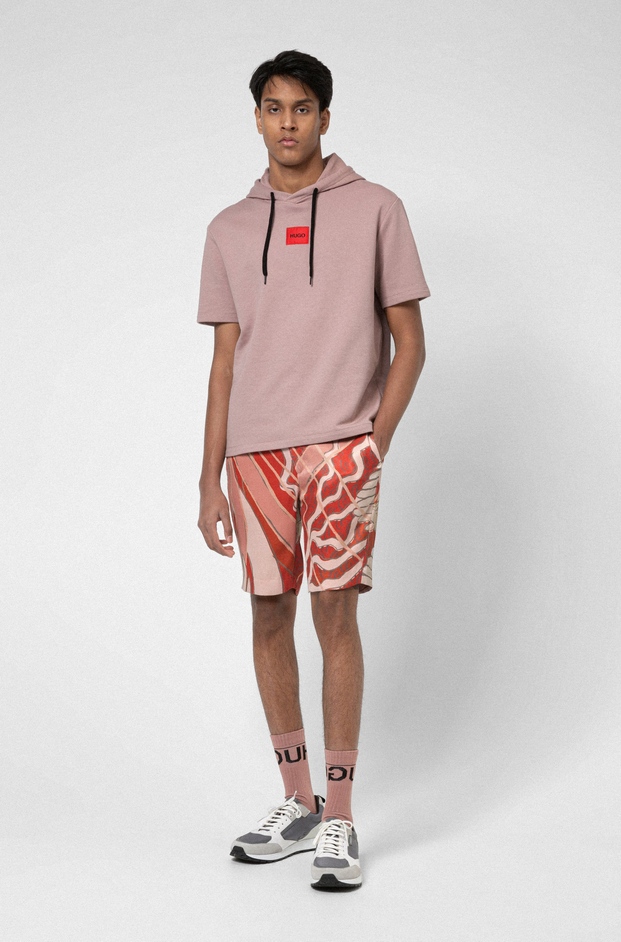 Slim-fit chino-style shorts with collection print