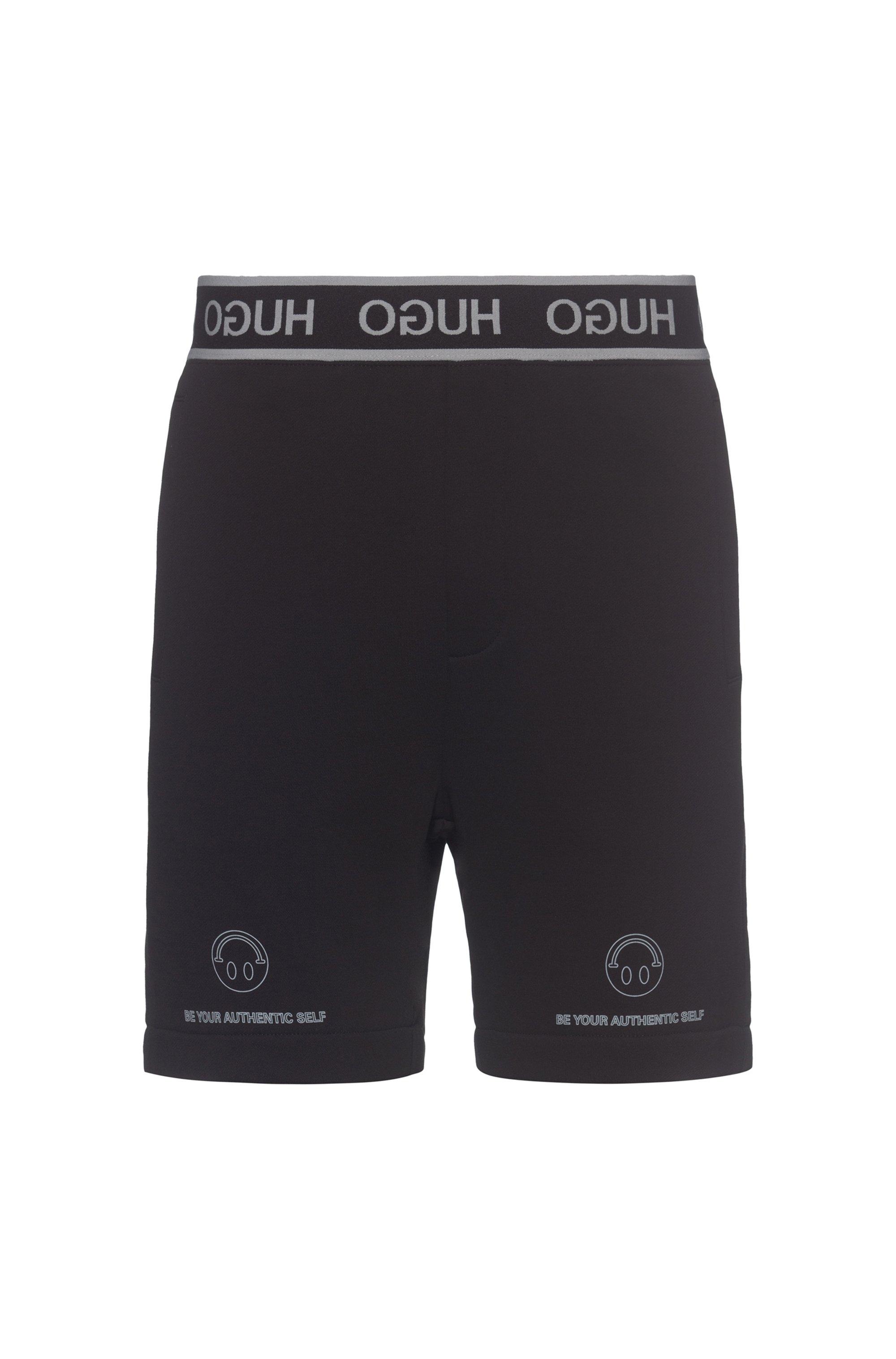 HUGO x Smiley® short en coton avec ceinture à logo inversé, Noir