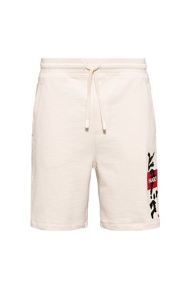 Logo shorts in French terry cotton with calligraphy artwork, White