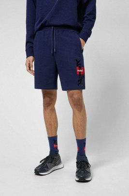 Logo shorts in French terry cotton with calligraphy artwork, Dark Blue