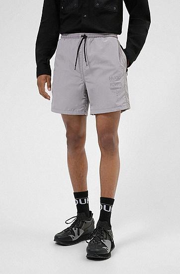 品牌宣言印花拉链口袋宽松短裤,  048_Silver