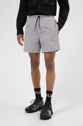 Relaxed-fit shorts with zipped pockets and manifesto print, Light Grey