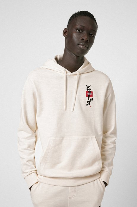 Relaxed-fit hoodie in French terry with calligraphy artwork, White
