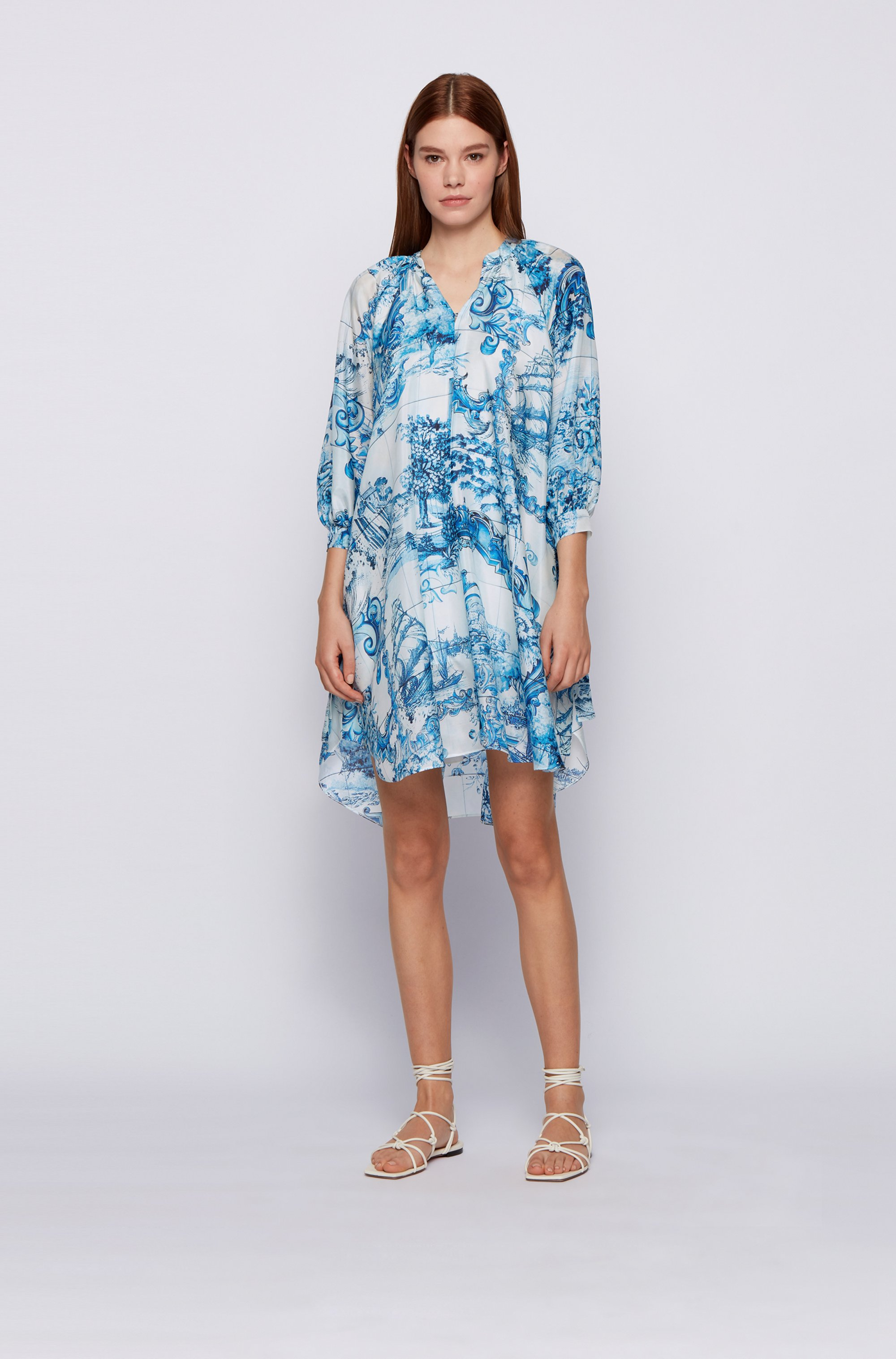 Silk swing dress in collection print with cuff ties