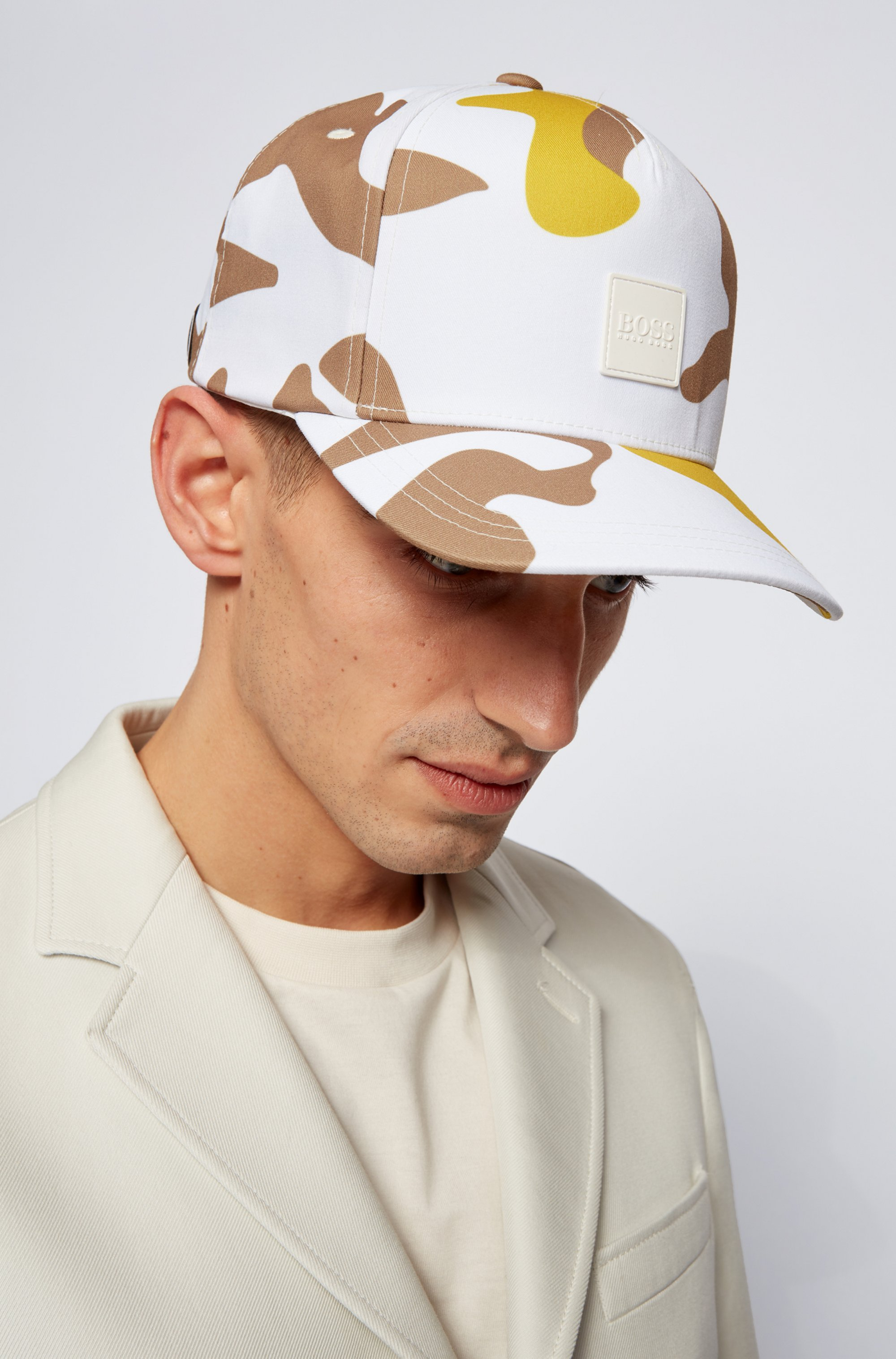 Camouflage-print cap with logo patch