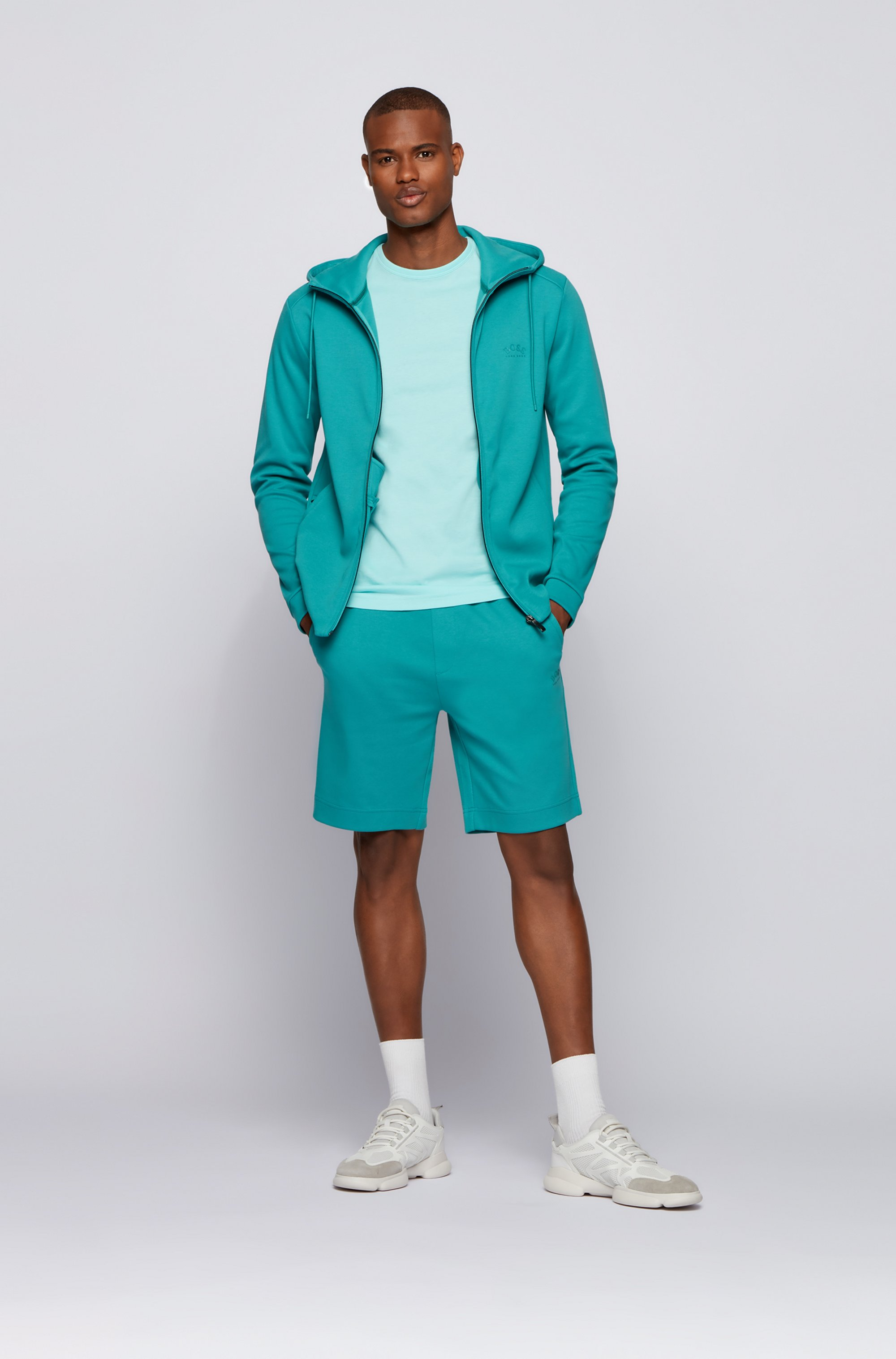 Mixed-structure hooded sweatshirt with zipped phone pocket