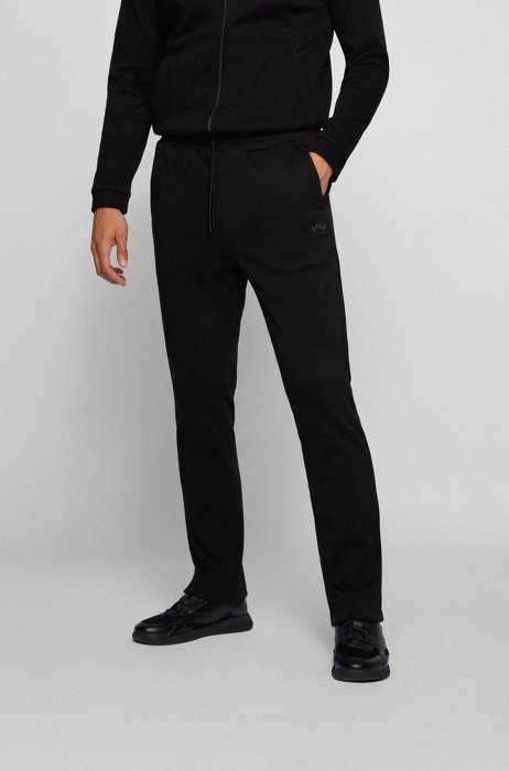 Cotton-jersey tracksuit bottoms with curved layered logo, Black