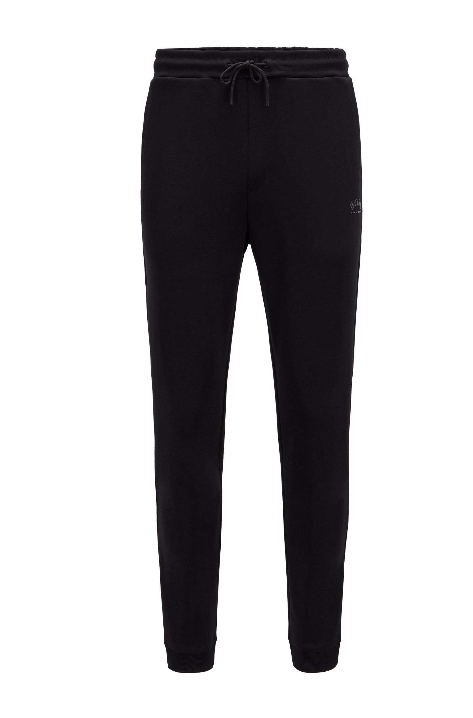 Cuffed tracksuit bottoms in cotton with tonal piqué structure, Black