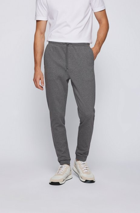Cuffed tracksuit bottoms in cotton with tonal piqué structure, Grey