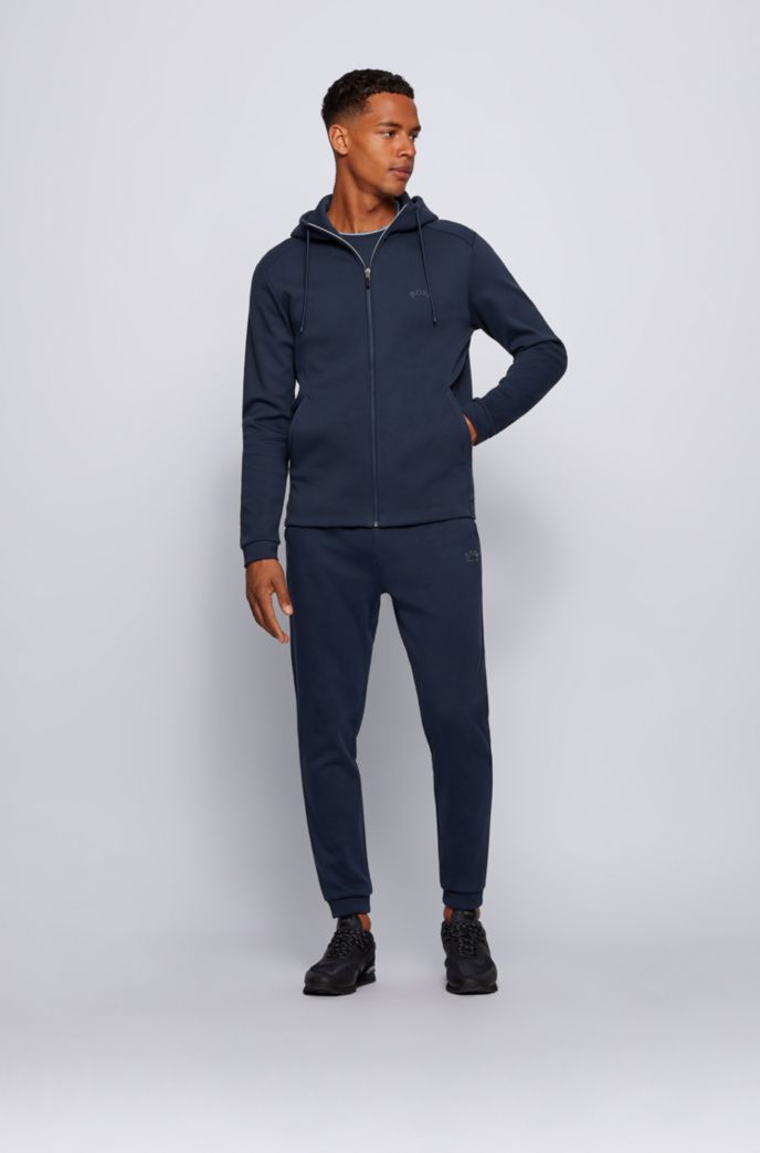 Cuffed tracksuit bottoms in cotton with tonal piqué structure