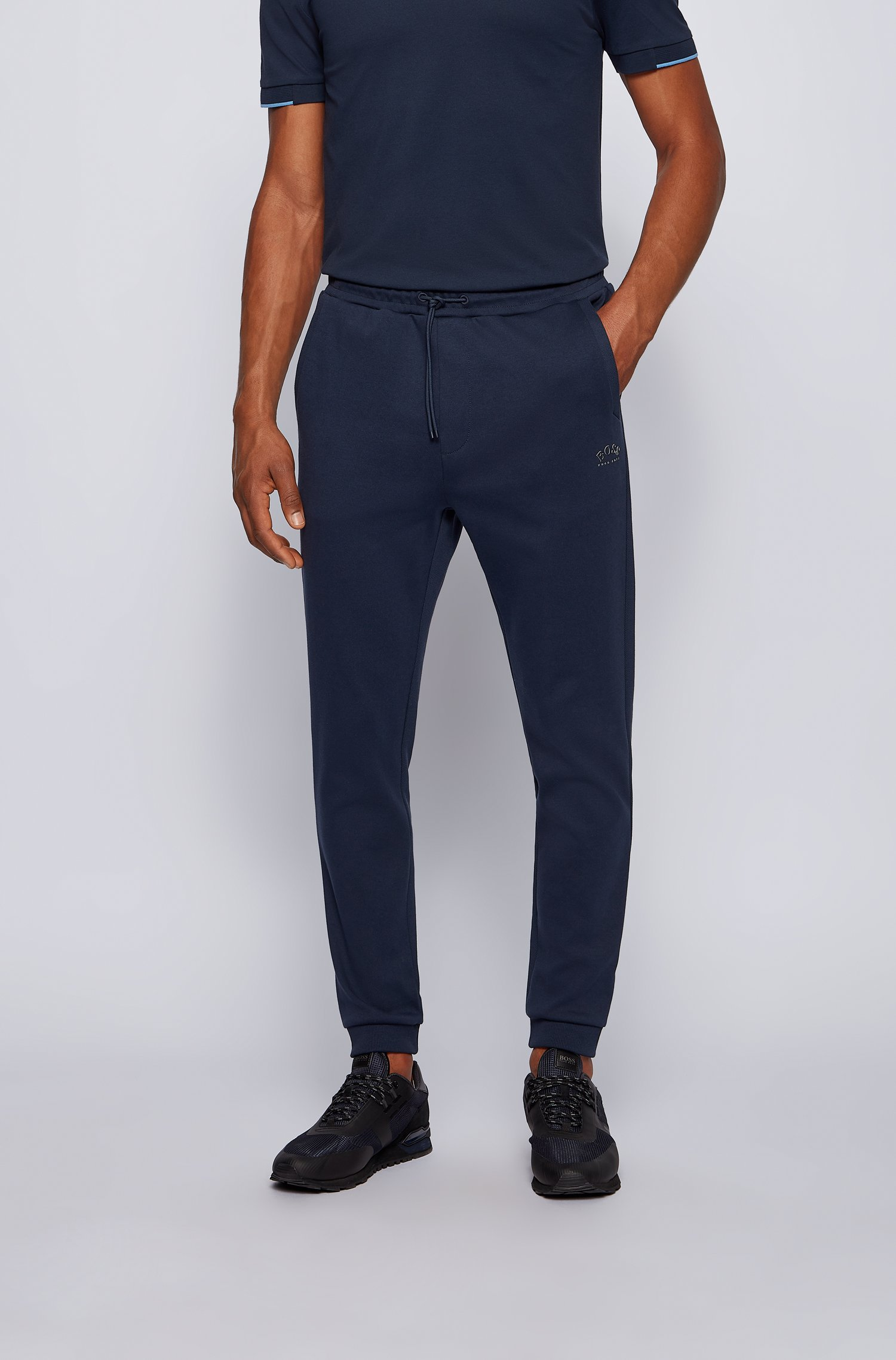 Cuffed tracksuit bottoms in cotton with tonal piqué structure, Dark Blue
