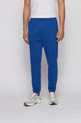 Cuffed tracksuit bottoms in cotton with tonal piqué structure, Blue