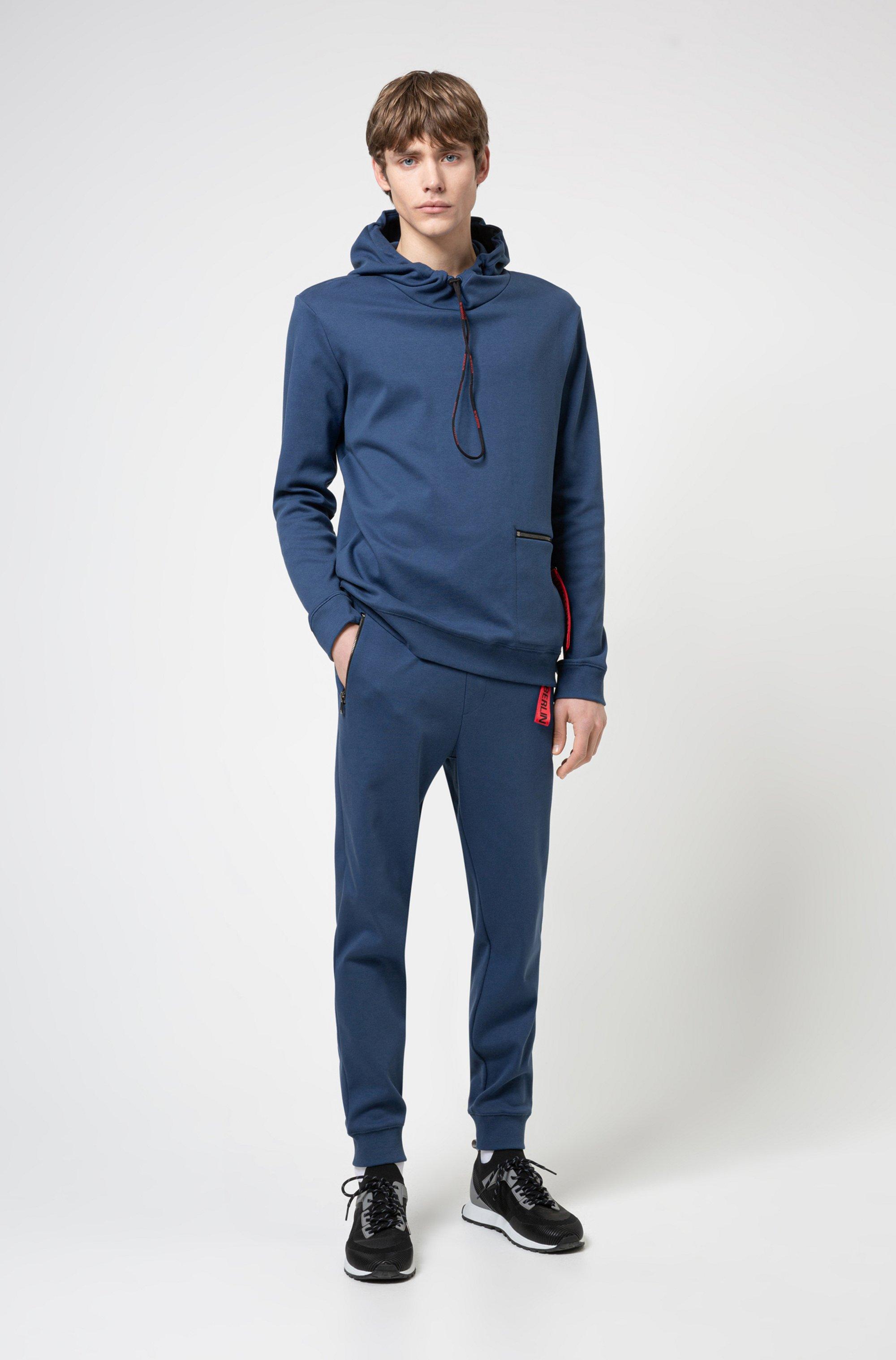 Kapuzen-Sweatshirt aus Interlock-Baumwolle mit Reißverschlusstasche