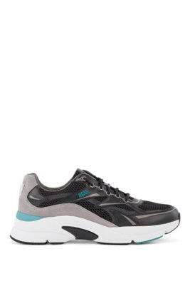 Running-inspired trainers in leather, suede and open mesh, Black