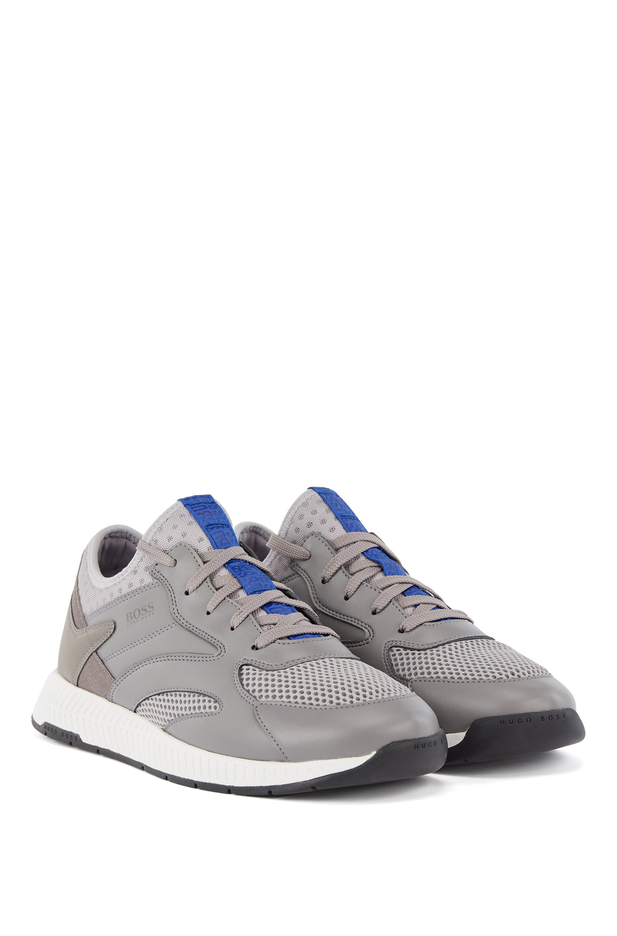 Leather-and-mesh trainers with decorative reflective trims