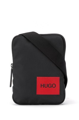 Reporter bag in recycled nylon with red logo label, Black