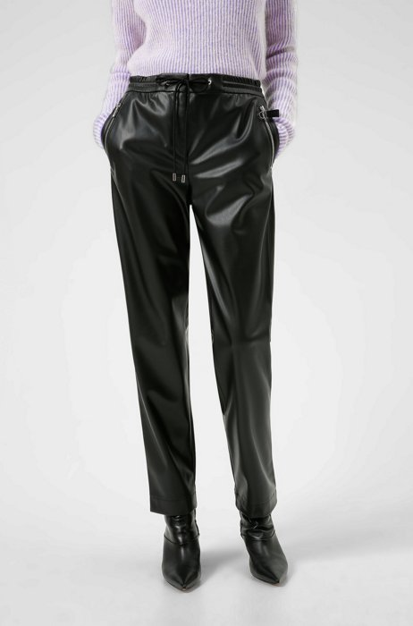Tapered-fit tracksuit bottoms in faux leather, Black