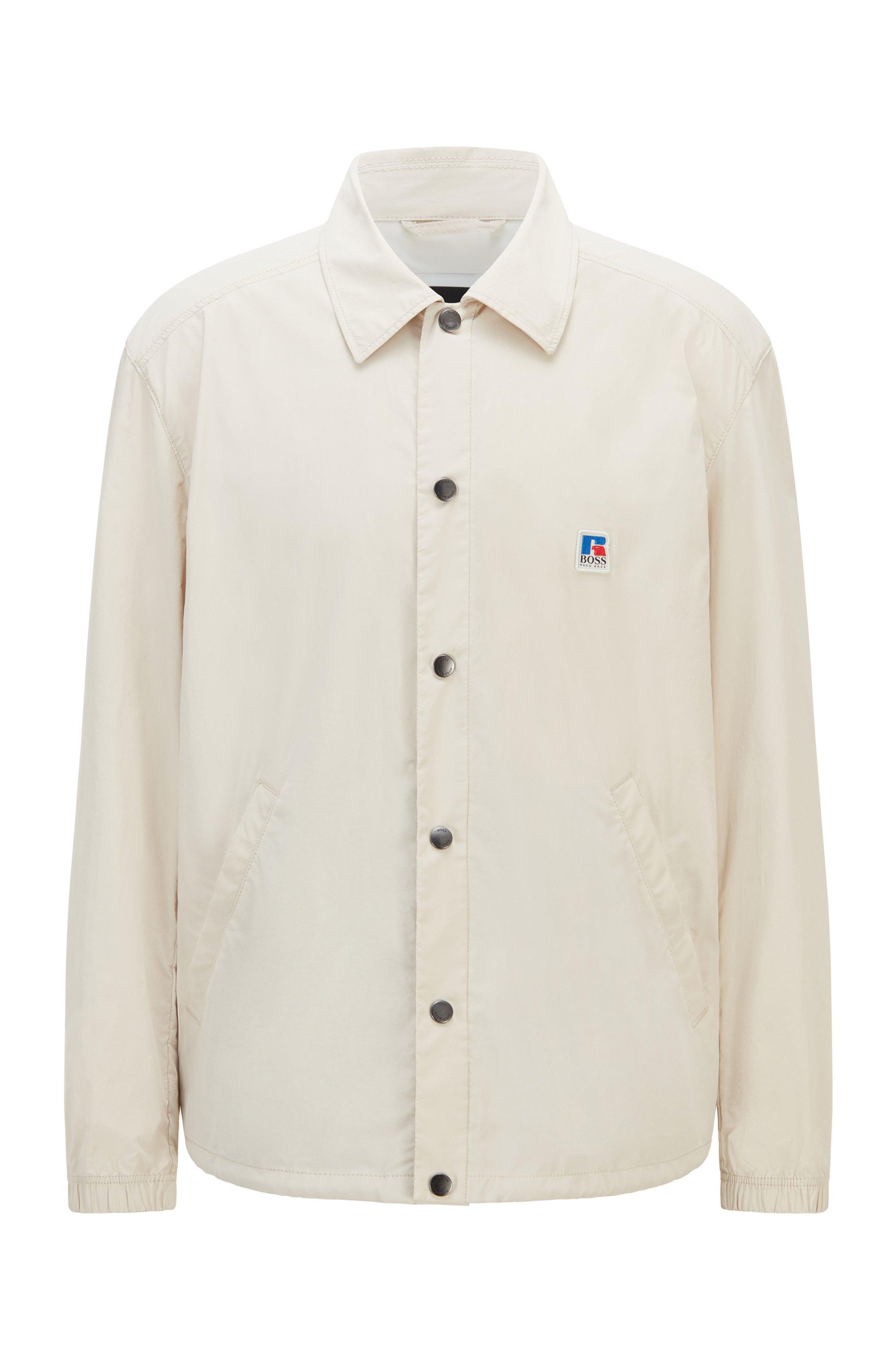 Cazadora relaxed fit en algodón recubierto con logo exclusivo, Beige claro