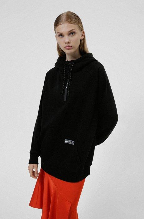 Lange relaxed-fit sweater met capuchon en silicone logo, Zwart