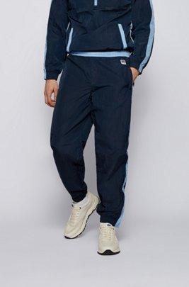 Bas de survêtement avec bordure contrastante et logo exclusif, Bleu foncé