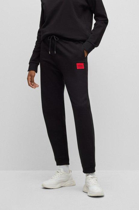 Pantalones de chándal en felpa de algodón con etiqueta con logo, Negro