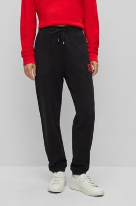 Cotton-terry tracksuit bottoms with red logo label, Black