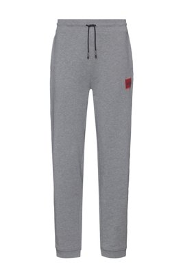 Jogginghose aus Baumwoll-Terry mit rotem Logo-Etikett, Grau
