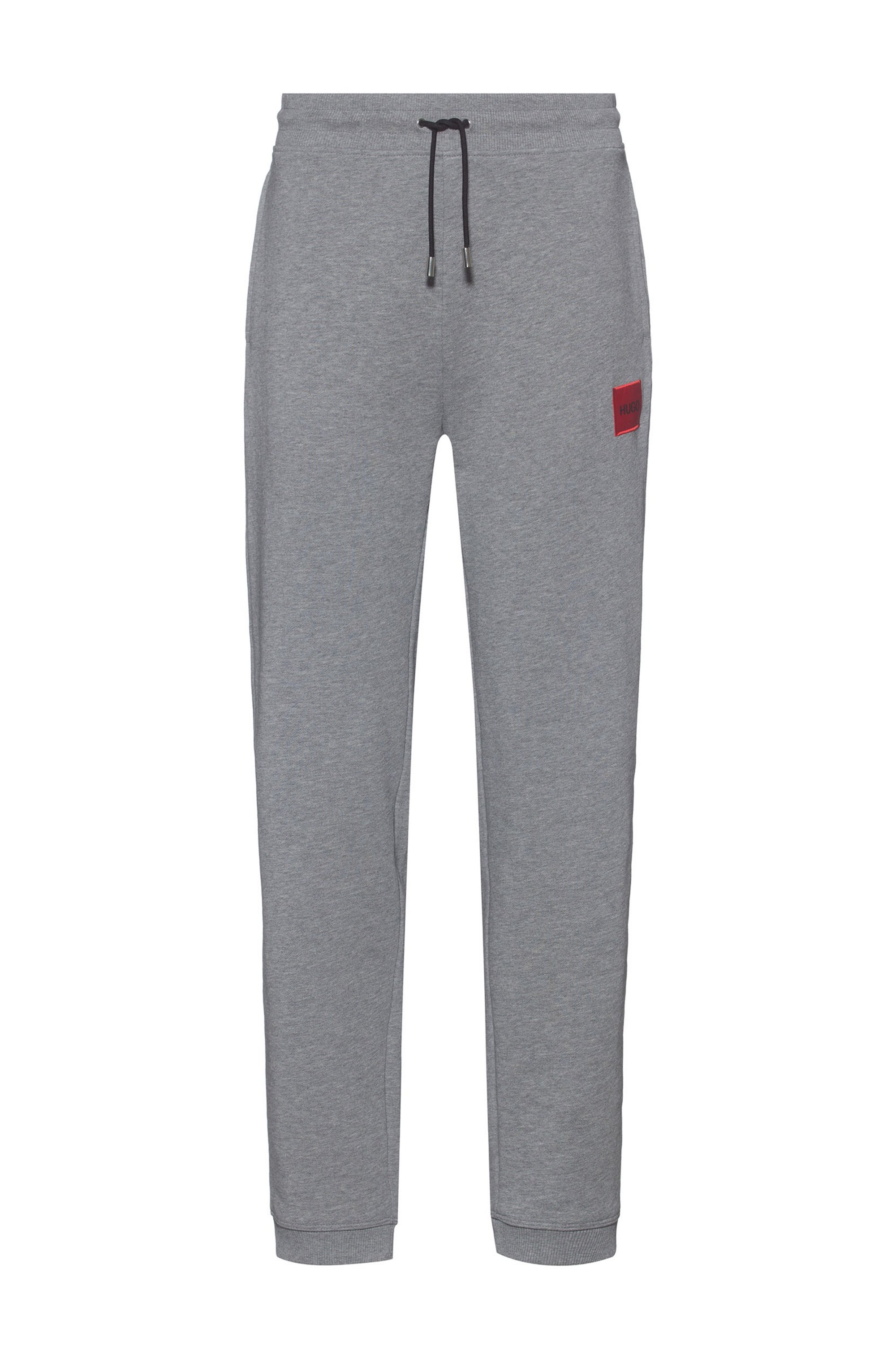 Cotton-terry tracksuit bottoms with red logo label, Grey