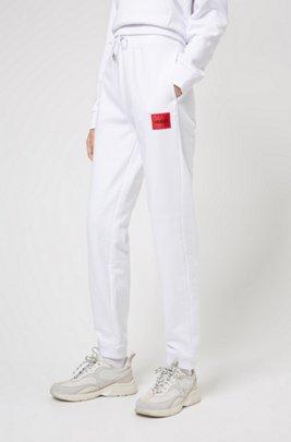 Jogginghose aus Baumwoll-Terry mit rotem Logo-Etikett, Weiß